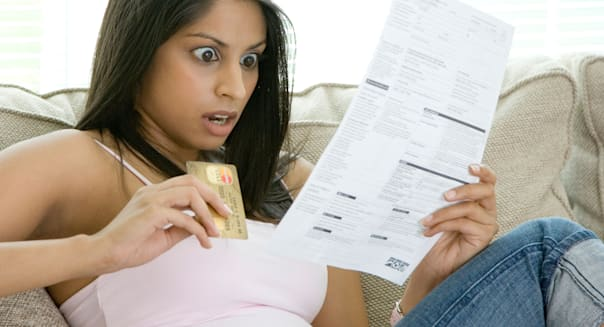 A young woman shocked by her credit card statement