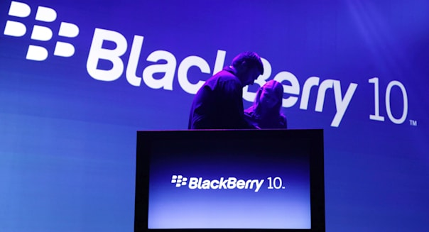 Stagehands prepare for the introduction of the BlackBerry 10, Wednesday, Jan. 30, 2013 in New York. The maker of the BlackBerry smartphone is promising a speedy browser, a superb typing experience and the ability to keep work and personal identities separate on the same phone, the fruit of a crucial, long-overdue makeover for the Canadian company. (AP Photo/Mark Lennihan)