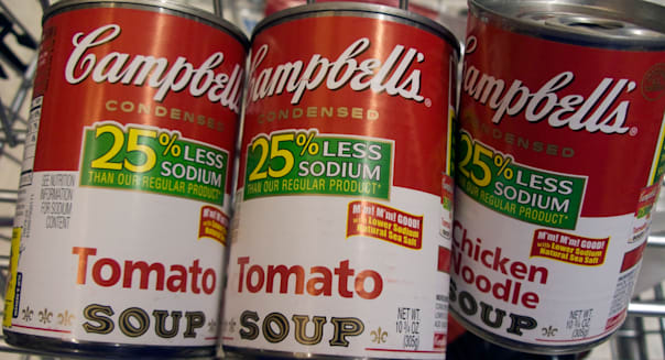 Cans of Campbell s tomato and chicken noodle soup are seen in a grocery cart in a supermarket in New York