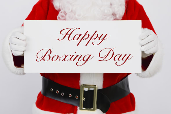 Santa Claus holding Happy Boxing Day sign