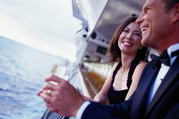 Couple Leaning on a Cruise Ship Railing
