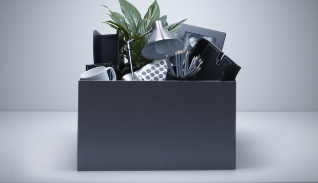 Box packed with desk objects
