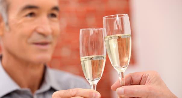 a mature man toasting.