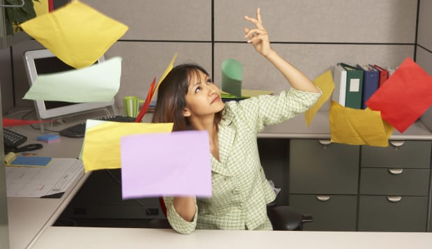 Businesswoman throwing office papers