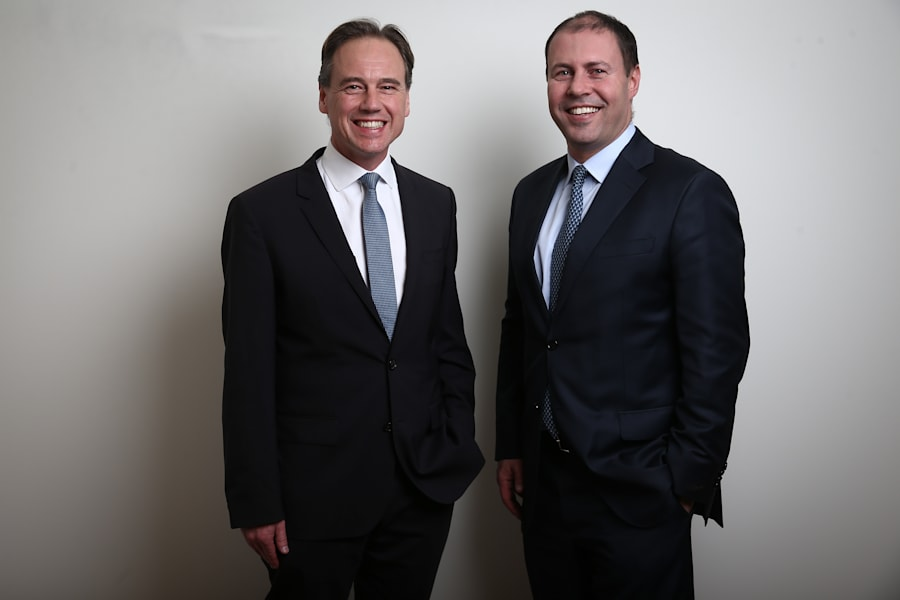 Out with the old, in with the new; outgoing Environment Minister Greg Hunt with his successor, Josh