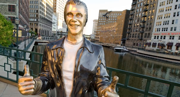Statue of Fonzie from the hit TV series Happy Days on riverwalk of Milwaukee River, Milwaukee, Wisconsin, USA