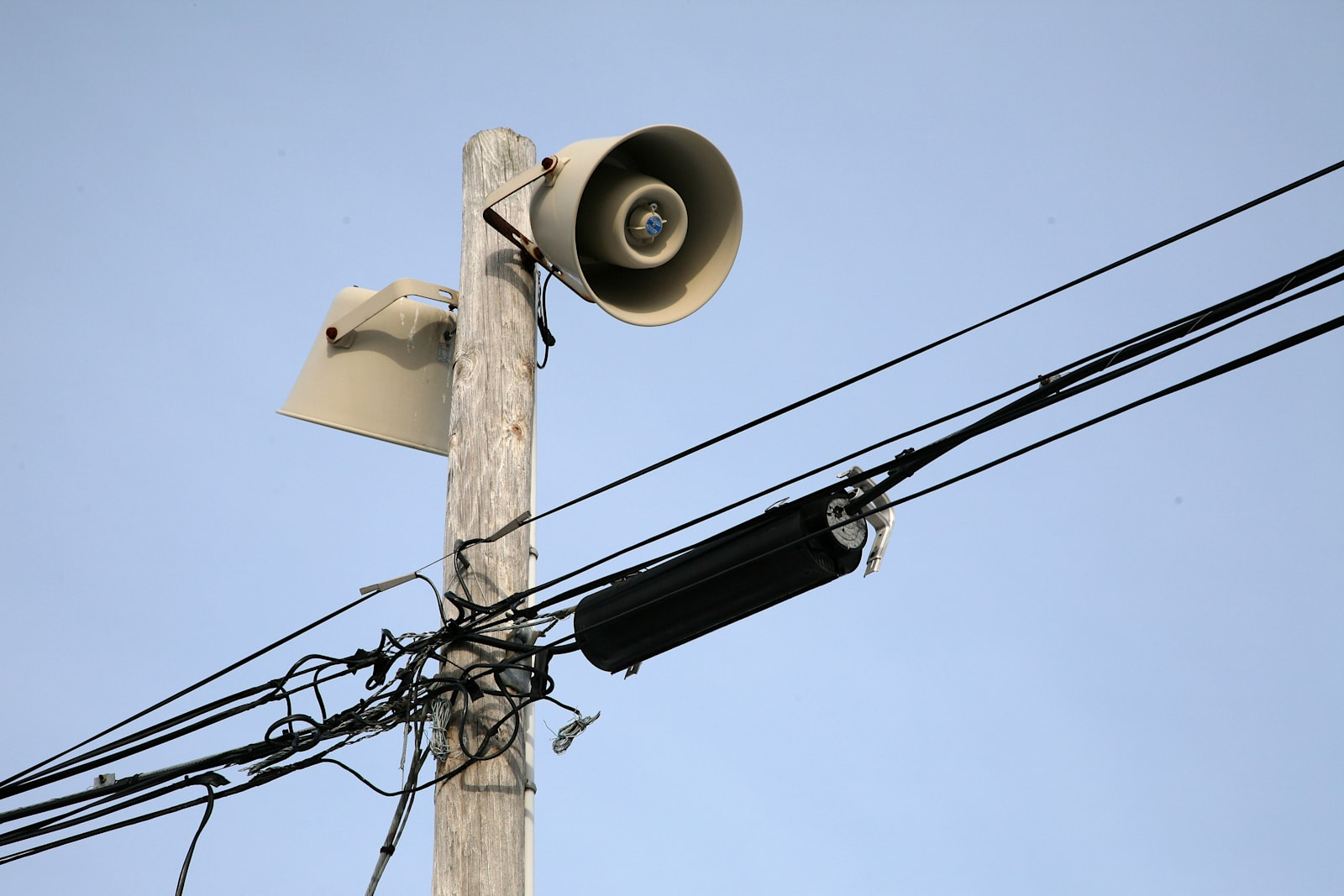 Warning sirens atop utility pole