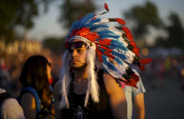 A festival-goer wears a Native American headdress during the Governors Ball Music Festival on Randall's...