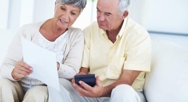 Mature couple calculating bills