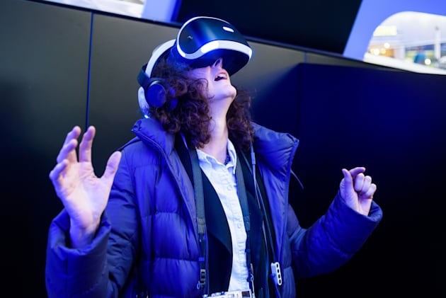 A woman wears a PlayStation VR
