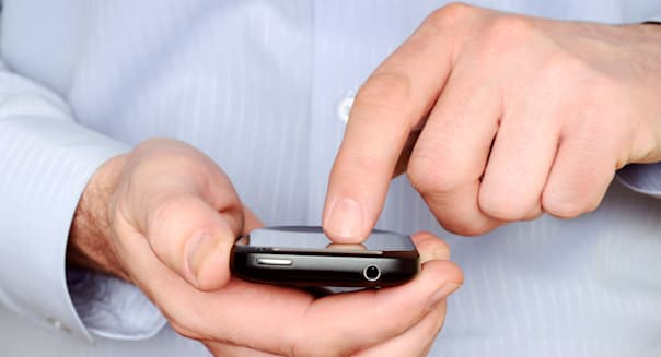 Man Using a Smartphone, Close Up.