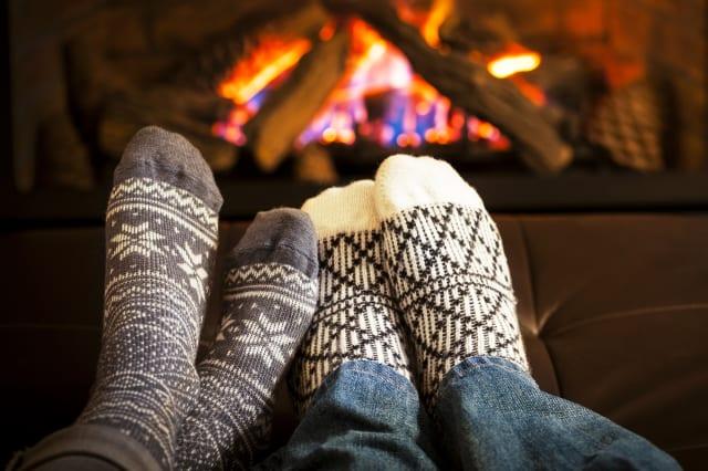 feet in wool socks warming by...