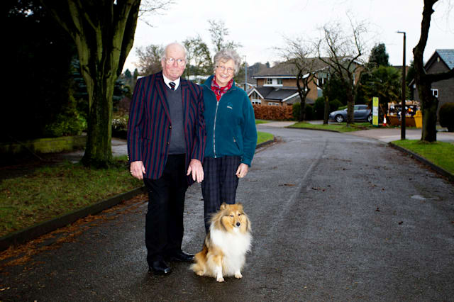 Derek and Patricia Read with their Shetland sheepdog Missy on Dormy Close, in Bramcote Nottinghamshire. 8/3/2017.  A postman who says he was chased by a cute Shetland sheepdog is refusing to deliver to residents on a Nottinghamshire street.  See NTI story NTIDOG.  Three-year-old bundle of fluff Missy, has allegedly chased one postie on his round which has resulted in most homes in the street not receiving mail since Christmas Eve.  One couple say the problem has been going on for 18 months.  Royal Mail has decided that residents in Dormy Close, in Bramcote, will have to do a four-mile round trip to Beeston Post Office if they want their letters or packages.  But owners of the dog, Derek and Patricia Read, said Missy was just doing her duty as a guard dog - but has never bitten a visitor to their home.