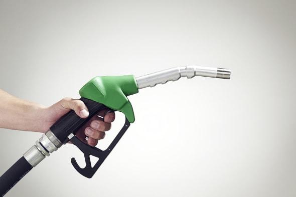Man holding a petrol pump, close-up of hand