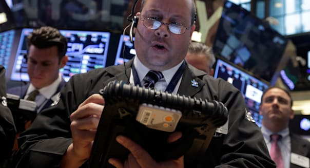 Wall Street (Trader Jeffrey Vazquez works on the floor of the New York Stock Exchange Friday, Oct. 11, 2013. Stocks were inching
