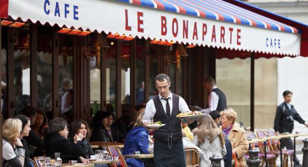 'Paris, France - April 27, 2012: Cafe Le Bonaparte in Paris. After World War II, St-Germain-des-Pres became synonymous with inte