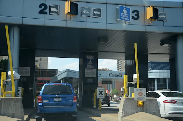 Cars wait to cross the border in Windsor, Ontario, Canada on June 27, 2014. Canadian retailers fear an...