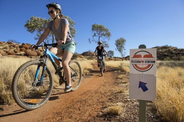 Mountain biking on the trail around Alice Springs Telegraph Station