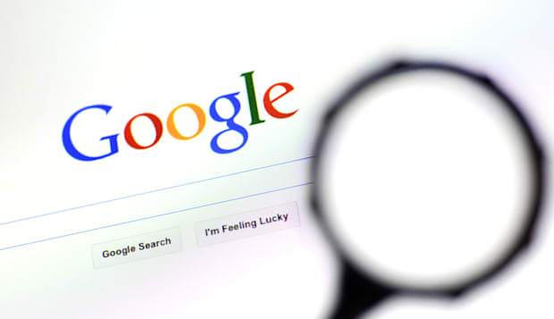 AUCKLAND - AUG 10 2014:Magnifying glass against Google homepage.Google search engine process over one billion search requests an