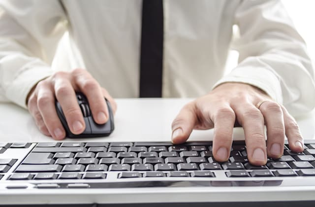 closeup of a man using computer....