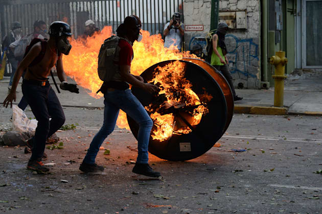 Opposition demonstrators clash with riot police ensuing an anti-government protest in Caracas, on July...