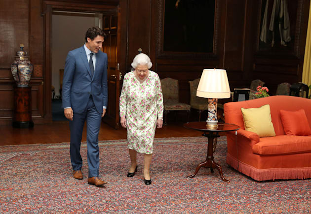Britain's Queen Elizabeth II greets Prime Minister Justin Trudeau during an audience at the Palace of...