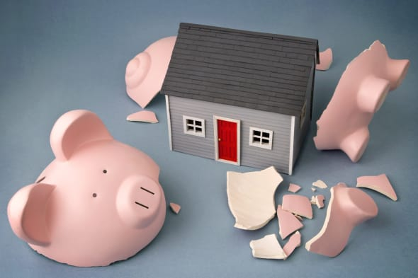 Broken piggy bank with home inside