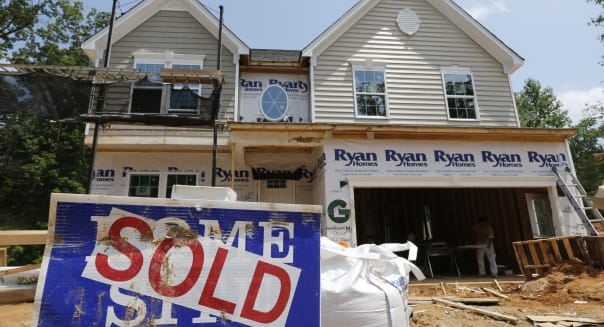 In this photo taken, June 8, 2015, a sold sign is displayed outside a new home under construction in Mechanicsville, Va. Freddie Mac, the mortgage company, releases weekly mortgage rates on Thursday, July 9, 2015. (AP Photo/Steve Helber)