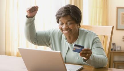 Senior African woman shopping online