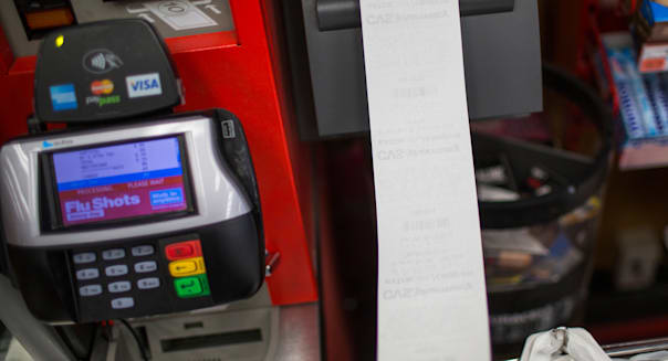 A long receipt exits a self service register at a CVS Pharmacy store in Brooklyn, New York.