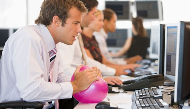 Businessman in office space with a ball