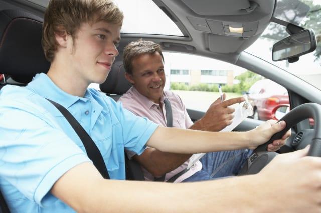 teenage boy taking a driving...