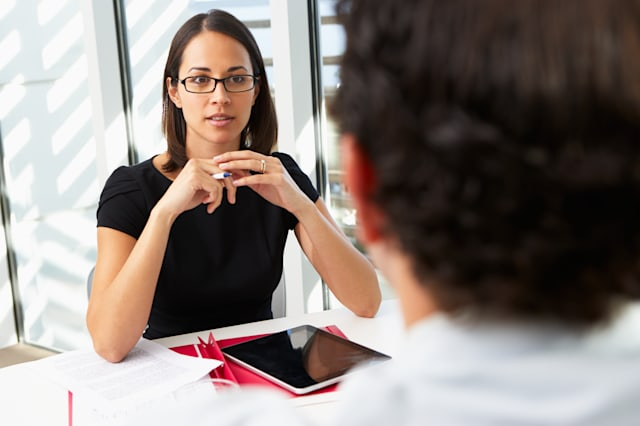 businesswoman interviewing male ...
