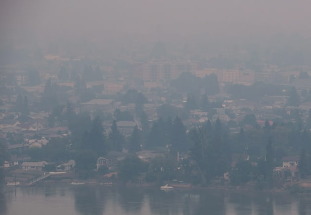 Smoke from wildfires burning in central B.C. shrouds the north shore of Kamloops, B.C., on