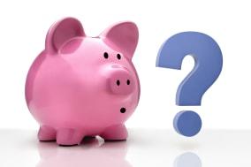 Pink piggy bank standing besides a blue question mark.