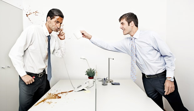 businessman throwing coffee to his colleague