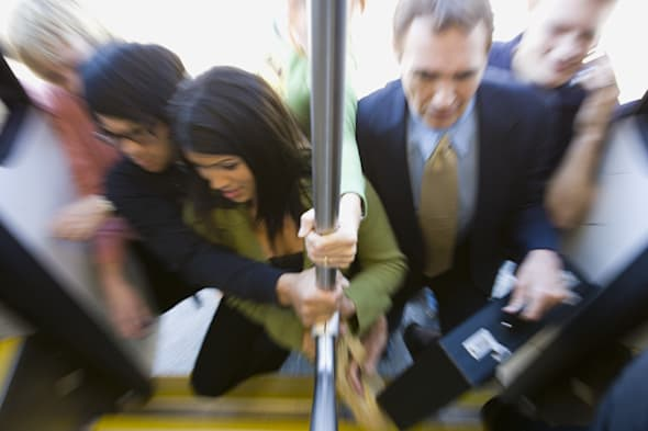High angle view of passengers boarding a commuter train