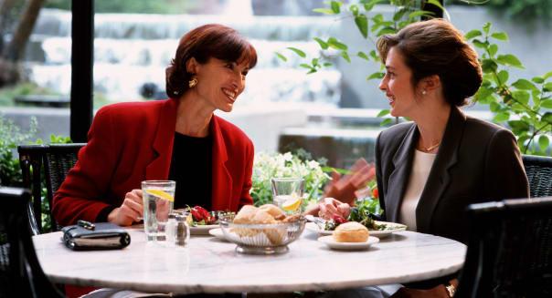 Two businesswomen having lunch
