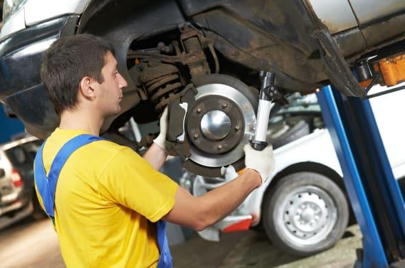 car mechanic examining car...