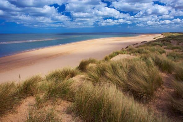 A view of the beach at Burnham Overy on the North Norfolk Coast looking towards Holkham