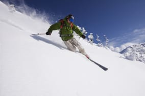 Asian man skiing