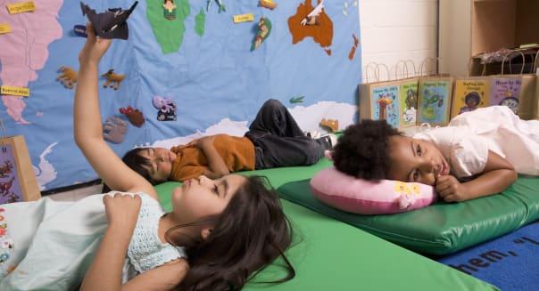 Children (2-5) relaxing in classroom