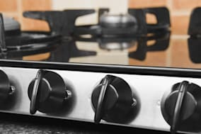 gas stove on a kitchen counter