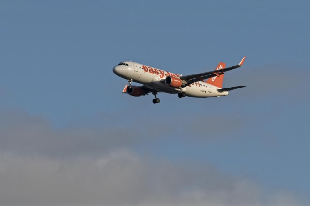 EasyJet  Airplane Flies On Its Descent Path Into Humberto Delgado Airport, Lisbon