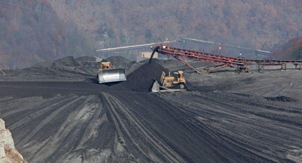 Bulldozer Spread Coal Mine Waste on Impoundment Dam