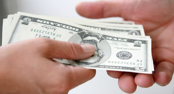 Two people exchanging money, close up of hands