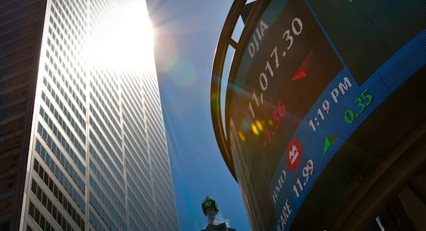 The Dow Jones Industrial Average stock market indices is displayed on an electronic board in Toronto financial district
