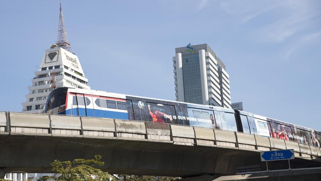 Mass transit sky train above Silom Road Bangkok Thailand