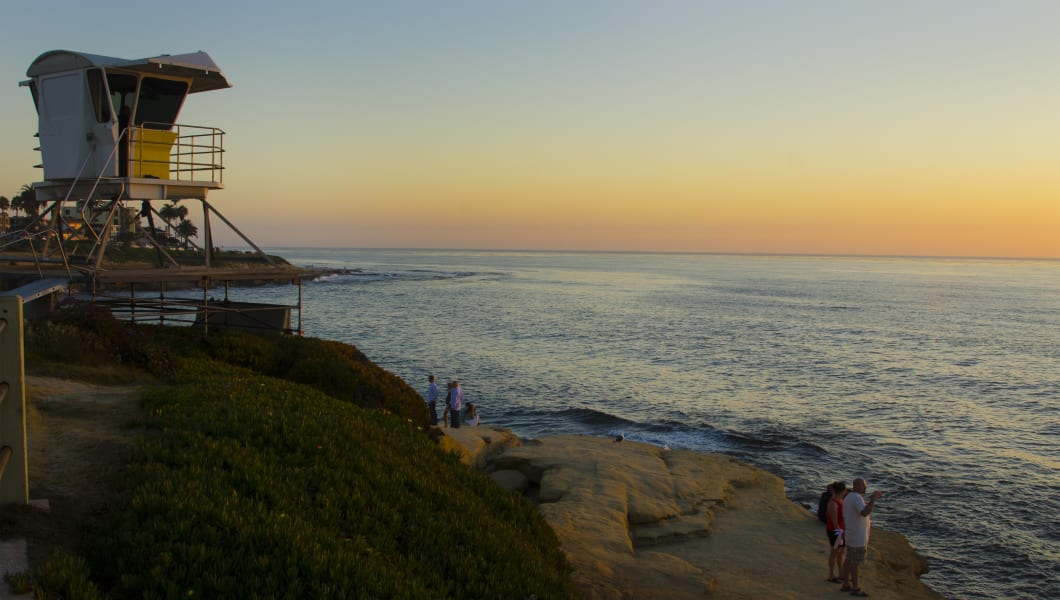 La Jolla sunset at The Cove with beach and lifeguard stand at twilight