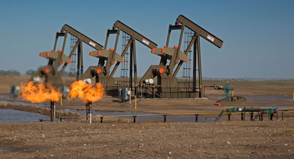 Watford City, North Dakota - Natural gas is flared off as oil is pumped in the Bakken shale formation.